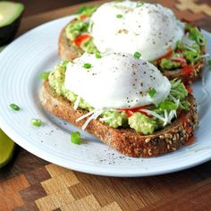 A simple Poached Egg Avocado Toast recipe that is absolutely delicious, with a spicy kick. Real, healthy food made with simple ingredients. Avocado Toast, Poached Eggs, Tostadas, Guacamole, Breakfast On The Go, Breakfast Ideas, Breakfast Recipes, Vegetarian Breakfast, Breakfast