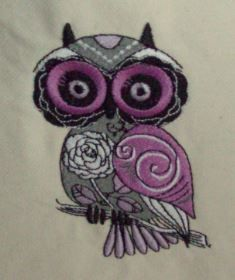 """Bag is 10"""" H x 9"""" W, Purple & Black art deco owl machine embroidery on an off white background. It has an adjustable shoulder strap, you can carry it over the shoulder or shorten the strap to carry it as a hand bag. Inside lining is black, has a top zipper closure. Has an inside pocket that will ..."""