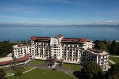 Located in a park, just 10 minutes by car from Evian city center, Hôtel Royal has a view of the Geneva Lake and offers a spa, wellness center,. Evian Les Bains, Leading Hotels, Lake Geneva, France, Hospitality, Mansions, Country, World, House Styles