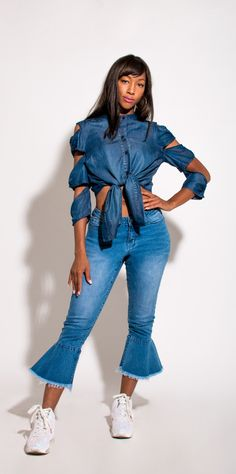 9e53fe2c708 This ladder-sleeve button down denim button-down shirt takes a runway  -inspired twist on a classic. Features high back and grandad collar.