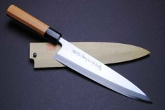"""Ao Namiuchi Blue Steel #1 Mioroshi Chef Knife 8.25"""" 210mm Yoshihiro - MADE IN JAPAN by YOSHIHIRO. $399.99. Premium grade Sashimi knife. Namiuchi forged (Wave pattern forged). Handle material : Yew. Knife material : Blue Steel # 1 (Aoko #1). significantly increases durability and sharpness. About YOSHIHIRO- """"YOSHIHIRO"""" has been designated as a one of the Best Sword Craftsman in Japan since 1550. Over 500 years of their sword making history and technique achieves one of ..."""
