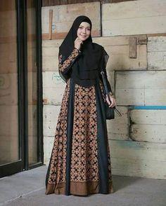 Image may contain: 1 person, standing Batik Fashion, Abaya Fashion, Fashion Dresses, Model Dress Batik, Batik Dress, Muslim Women Fashion, Islamic Fashion, Blouse Batik Modern, Batik Muslim