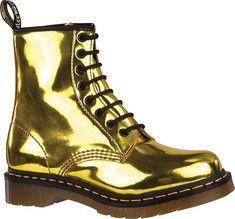 Doc Martens 8-eye gold boots.