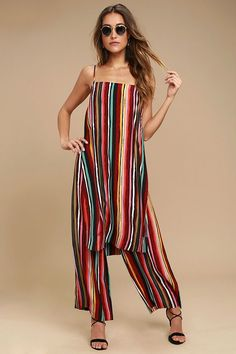 The Free People Ruby Multi Striped Two-Piece Set was made for dreamers and magic makers! Vibrant multicolored stripes decorates this woven two-piece jumpsuit that includes a maxi top, with skinny straps and side slits, and matching wide leg pants with an elasticized, drawstring waist.