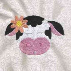 This free embroidery design is a cow.
