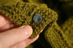 Clever tip for sewing buttons onto knits: use felt rather than a backing button for strength AND flexibility -- from Julia Farwell-Clay