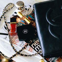 A classic Chanel cross body bag filled with blogger beauty must-haves, Tom Ford and La Mer.