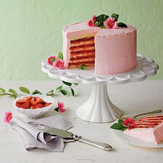 Strawberries and Cream Cake | Imagine a multi-layered fusion of fresh strawberry pie and feather-light sponge cake. Unlike the original strawberry cake-mix classic, this ones made from scratch. | SouthernLiving.com