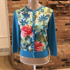 Ann Taylor turquoise w/ floral front cardigan Small stain on back of sleeve as shown, otherwise in great condition at great price. Ann Taylor Sweaters Cardigans