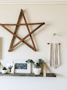 """So much to love in this living space! Wooden shelf with leather """"brackets,"""" the art, the handmade wall hanging..."""