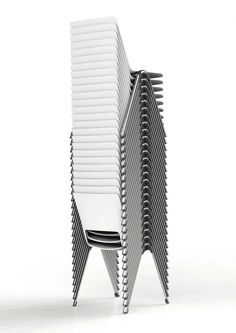 The issue with the design of most stacking chairs is that, when stacked, they look like this: That is to say, each stacked chair nests slightly forward of the one beneath it. That's fine for homes or offices that only require a half-dozen of these. But for institutions and convention