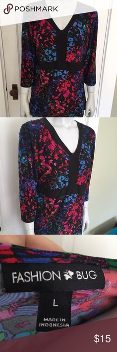 Fashion Bug colorful stretchy blouse Nice black shirt with three quarter length sleeves and pink, blue, and red abstract pattern. Very flattering and comfortable. Great for work or worn casual. Fashion Bug Tops Blouses