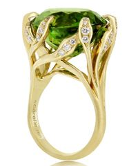 Vines of yellow gold and diamond gracefully hold the peridot gemstone in place, which makes for a stunning statement piece that any August birthday girl would love to have. Ring by Carelle