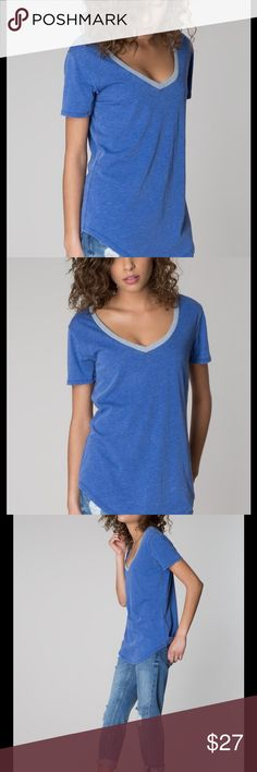 Ringer V Electric Blue A spin on the classic ringer tee, this essential top is crafted from our Signature Burnout fabric and designed with the same relaxed fit as our coveted Pocket Tee. Signature Burnout 60% Cotton 40% Polyester. Our signature burnout garments are specially treated for perfectly imperfect variations in color that will evolve with wear and washing. To care, hand wash or machine wash cold, gentle cycle, lay flat to dry as a heated dryer will accelerate the aging process…