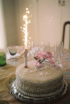 gorgeous birthday cake + candle (firework!?).