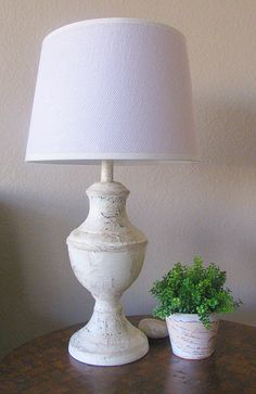 DIY Pottery Barn knock-off lamps from old brass lamps. Modge podge, tissue paper, paint land glaze...that's it. Tutorial