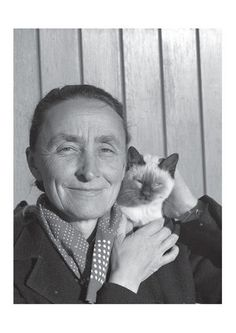 """Georgia O'Keeffe with cat-""""Nobody sees a flower really; it is so small. We haven't time, and to see takes time - like to have a friend takes time."""" Georgia O'Keefe."""