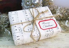 This site has a bunch of cute ways to wrap by reusing stuff you already have.  The rest of the site is cute too!