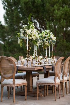 Archive Rentals Riviera Table and Sophia Chairs paired with our candlesticks and tall floral arrangements created by Krista Jon for Archive is the perfect mix of a Tuscan Romance. Read More: www. Tall Floral Arrangements, Wedding Arrangements, Wedding Centerpieces, Wedding Table, Wedding Reception, Masquerade Centerpieces, Reception Decorations, Event Decor, Table Decorations