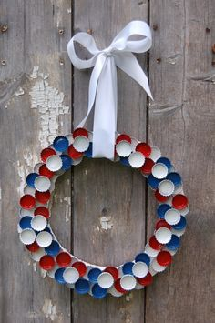 A patriotic bottle cap wreath tutorial in time for the 4th of July.