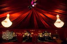 Our chandeliers and red velvet linings at a winter wedding
