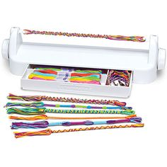 LoopDeDoo Spinning Loom- This spinning loom helps you make necklaces, bracelets and anklets in minutes! Wrap threads around the LoopDeDoo loom, turn the knob and guide the thread. That's all there is to it. Includes spinning loom, 18 different colored skeins of embroidery thread and detailed instructions. Start crafting! For ages 8 yrs-teen. From Ann Williams Group.