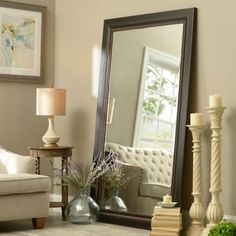 cute way to do decor with Floor Mirror in LVRM .. side table betwn bed with large vase.candles and side pic