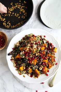 Serve this roasted pumpkin quinoa salad as a meal or side dish. The pumpkin is roasted with red onion, cumin, coriander, fennel seeds and maple. It's delicious. The quinoa is dressed with are lots of herbs, sumac, lemon and topped with the roasted pumpkin, pomegranates, pepitas and hazelnuts - whats not to love...