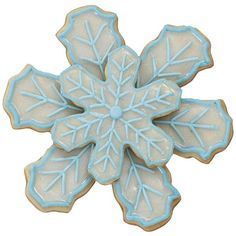 Snowflake Shine Cookies - A magical twinkling of the season sparks on snowflake cookies covered with white sparkle gel. Nesting snowflakes are stacked, covered with gel and outlined in blue detail.