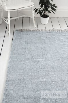 Jord Home natural fibre rug in flint grey designed to add depth and texture to a neutral scheme. Woven by hand on a traditional wooden loom. Made from