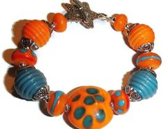 Lampwork Bead Bracelet Blue and Orange Fun Bracelet Colorful Bright by riversedgecreations. Explore more products on http://riversedgecreations.etsy.com