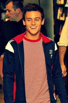 Tom Daley. let's be honest. he's way too gorgeous for his own good. :) Don't deny it. ;)