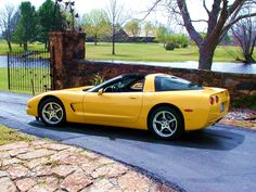 Yellow C5 Corvette....the closest I'll get to owning one is my boyfriend's...at least I get to look at it in MY garage where he stores it. Hey! I own it-possession is 9/10th of the law!!!!??