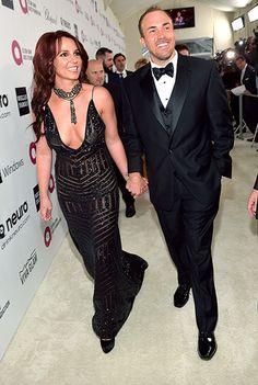 Pop goddess Britney Spears (in Michael Costello Couture) descends onto Elton John's Oscar bash with her boyfriend, David Lucado