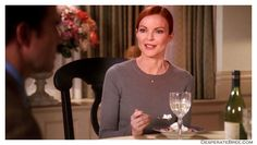 Bree Van De Kamp Desperate Housewives style outfit clothes grey long sleeved sweater top sleeves casual low key sober widow diamond pearl necklace earrings jewels jewellery hair slick pulled back in a bun dinner dessert george dining room flowers evening home interior decoration set decor chair
