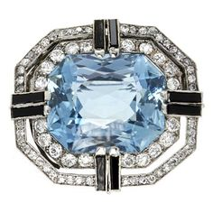 An Art Deco aquamarine, onyx and diamond brooch, ca 1925