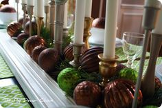 LOVE this website. Lots of great redecorating ideas. Hope to gather the materials for this centerpiece and change the decor at the base of the candlesticks for each season/holiday.