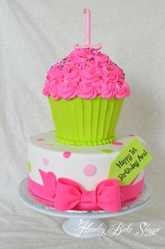 "Cupcake Cake - Top Tier - BC ""wrapper"" and BC icing w/ fondant #1 Bottom tier - fondant w/ fondant bow and tag"