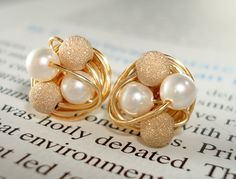 Petite white pearl / gold Star Dust - Mix It Up Series- Swarovski Glass Pearl and Stardust bead Wire Wrapped Stud Earrings via Etsy.