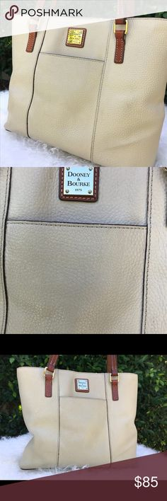 """✨Dooney & Burke Pebbled Leather Purse✨ Beautiful and classic authentic Dooney & Burke purse! Pre-loved but lovely cream colored pebbled leather with signature brass hardware on front. Slip pockets on front and back. Brown leather handles. Red canvas interior, zip closure pocket inside. Width is 10"""", length is 13.5"""" and handles are about 12"""". Great bag! Just needs a little cleaning on the inside but still in nice condition❤️ Dooney & Bourke Bags"""