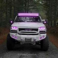 White GMC Sierra diesel truck with pink dual light bars and pink halos, the only time I would get something with pink! Lifted Chevy Trucks, Gmc Trucks, Diesel Trucks, Cool Trucks, Pickup Trucks, Pink Chevy Trucks, Lifted Silverado, Camo Truck, Pink Truck