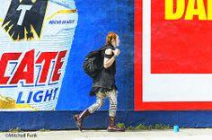 Women Walking Between Two Poster In TheTenderloin District, San Francisco By Mitchell Funk   www.mitchellfunk.com