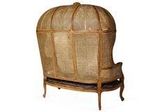 An antique hooded cane settee from our sale with Kelly Wearster, does it get any better?!