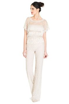 Jump For Joy — Chantilly lace and swiss dots might not be your thing, but you have to admit that the effect is pretty spectacular when they show up on a jumpsuit. Photo: Courtesy of Moda Operandi.