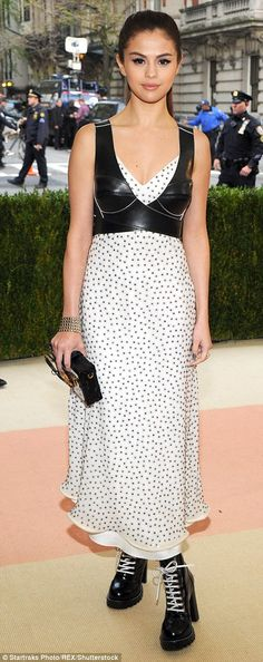 Odd choices: Selena Gomez hit the red carpet at the Met Gala this year in a white studded ...