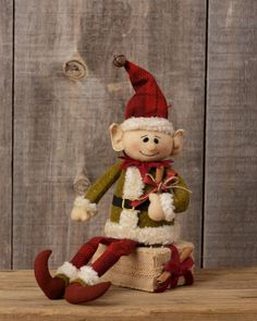This is a new little elf doll made of felt and fabric that sits on a burlap box. Christmas Elf Doll, Christmas Swags, Christmas Bells, All Things Christmas, Christmas Presents, Christmas Holidays, Primitive Country Christmas, Primitive Santa, Rustic Christmas