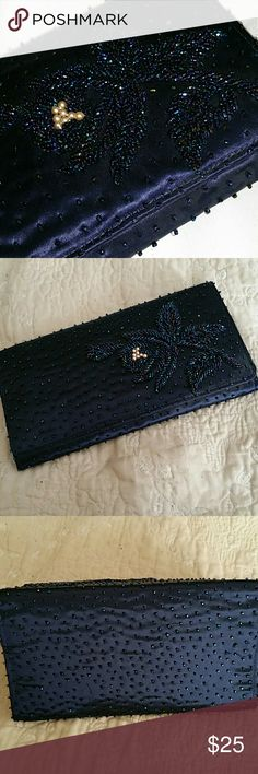Vintage Faris Freres beaded clutch Stunning vintage deep purplish-blue clutch with jade,  purple,  & navy beading in floral pattern. Center of flower are faux pearls.  Faris Freres handmade in the Crown Colony of Hong Kong. Has a zippered pocket & an elastic pocket with a matching coin purse. Missing a couple of beads on the back of the purse.  Priced accordingly. Faris Freres  Bags Clutches & Wristlets