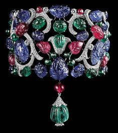 Platinum bracelet with carved emeralds, rubies, sapphires and brilliants
