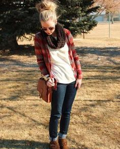 Messy bun, detailed designed sweater, white T, brown scarf,  jeans and boots