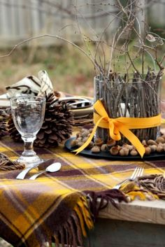 Love the plaid blanket as a tablecloth and the simplicity oh the twigs and pinecones So many possibilities and color options depending on your blanket choice